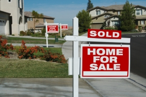 Home For Sale Signs In Front Of Beautiful New Homes.
