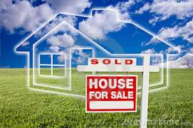 sold-sale-sign-over-clouds-grass-house-14063253